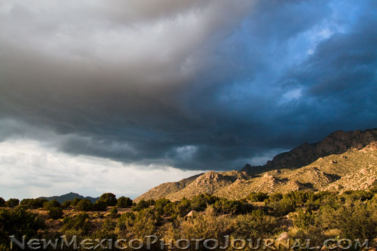 a storm moves in over the sandia mountains