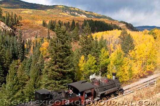 A Cumbres & Toltec train works its way up the tracks, north of Chama