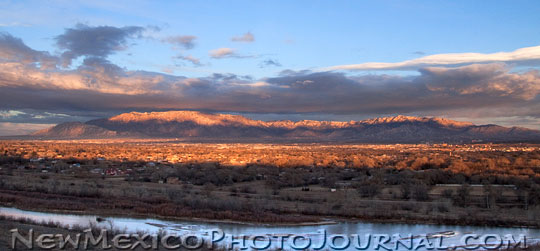 The Rio Grande in the foreground with the Sandia mountains in the background