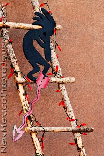 Kokopelli and Christmas lights on an Old Town ladder