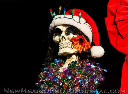 a calavera dressed up like Santa Claus