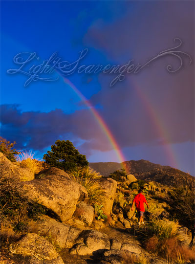 A double rainbow over the Sandia foothills.