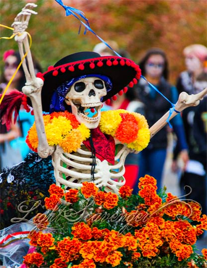 An exuberant skeleton makes her way through the annual Marigold Parade