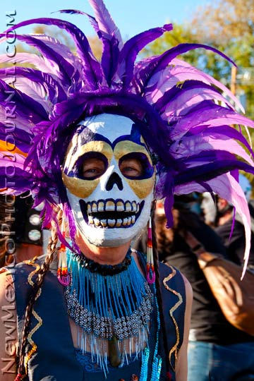 Dancer with mask and purple feathers
