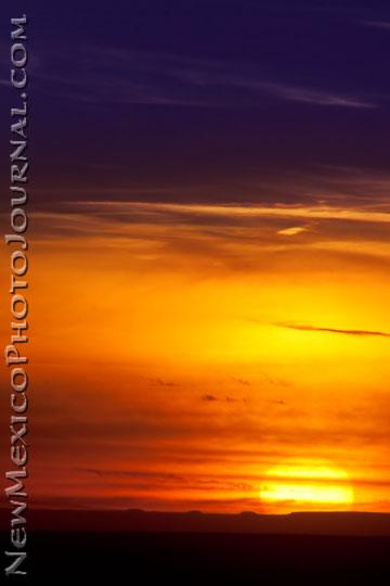 the sun as it slips beneath the horizon