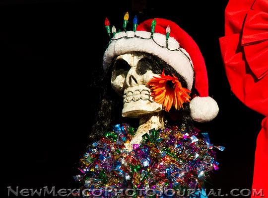 a calavera dressed up like Santa Claus