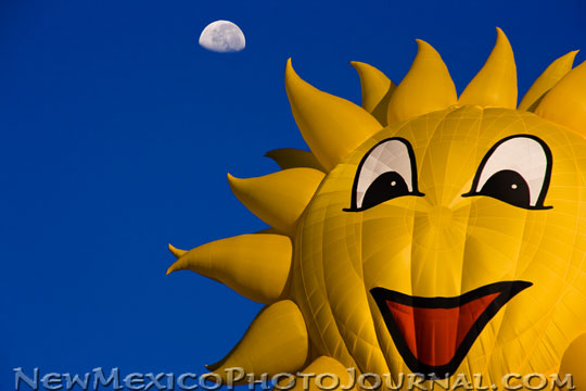 Sunny Boy, a special shapes hot air balloon, rises into the morning sky at the Albuquerque International Balloon Fiesta.