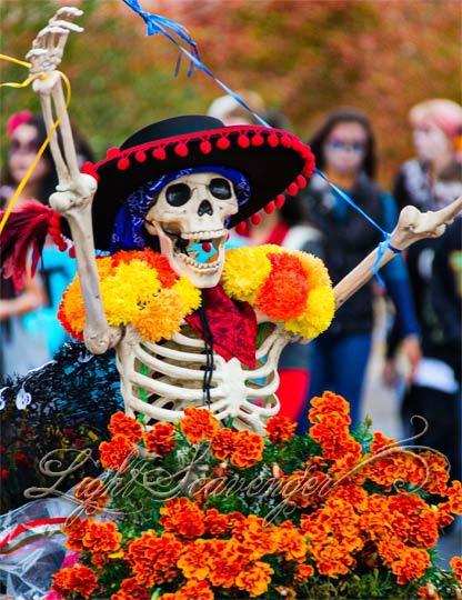 An exuberant skeleton makes her way through the annual Marigold Parade