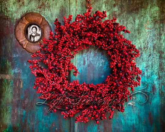 Red wreath on old door